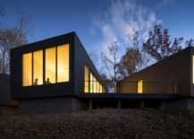 Lighting adds warmth to the minimal contemporary home in woods