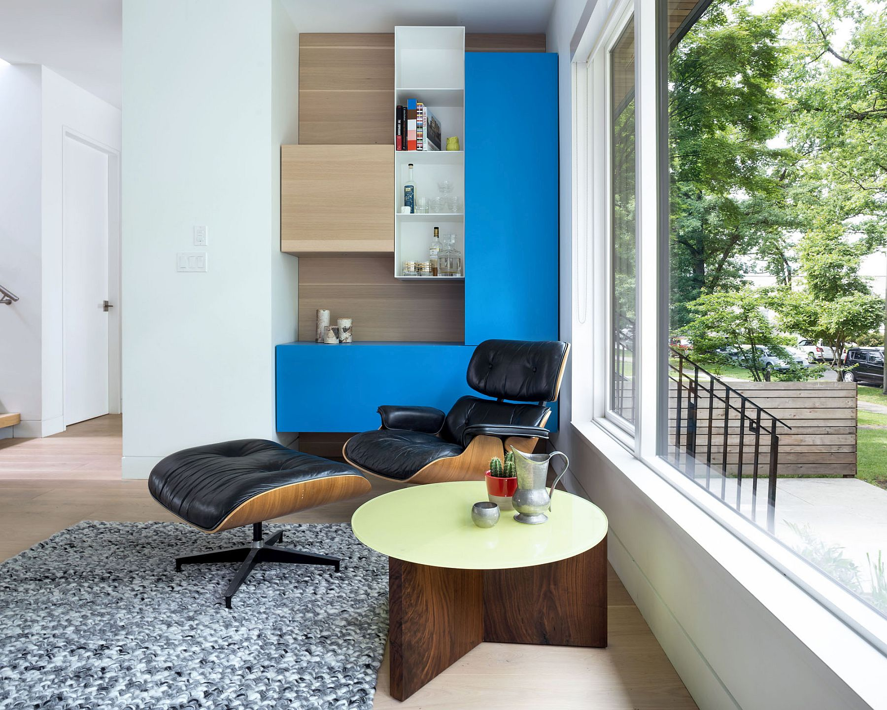 Living area with the classic Eames Lounger and colorful modular shelving
