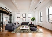 Living room and study of the smart, revamped NYC apartment