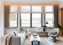 Living-room-in-white-with-gray-drapes-exposed-brick-wall-and-NYC-loft-inspired-look-217x155