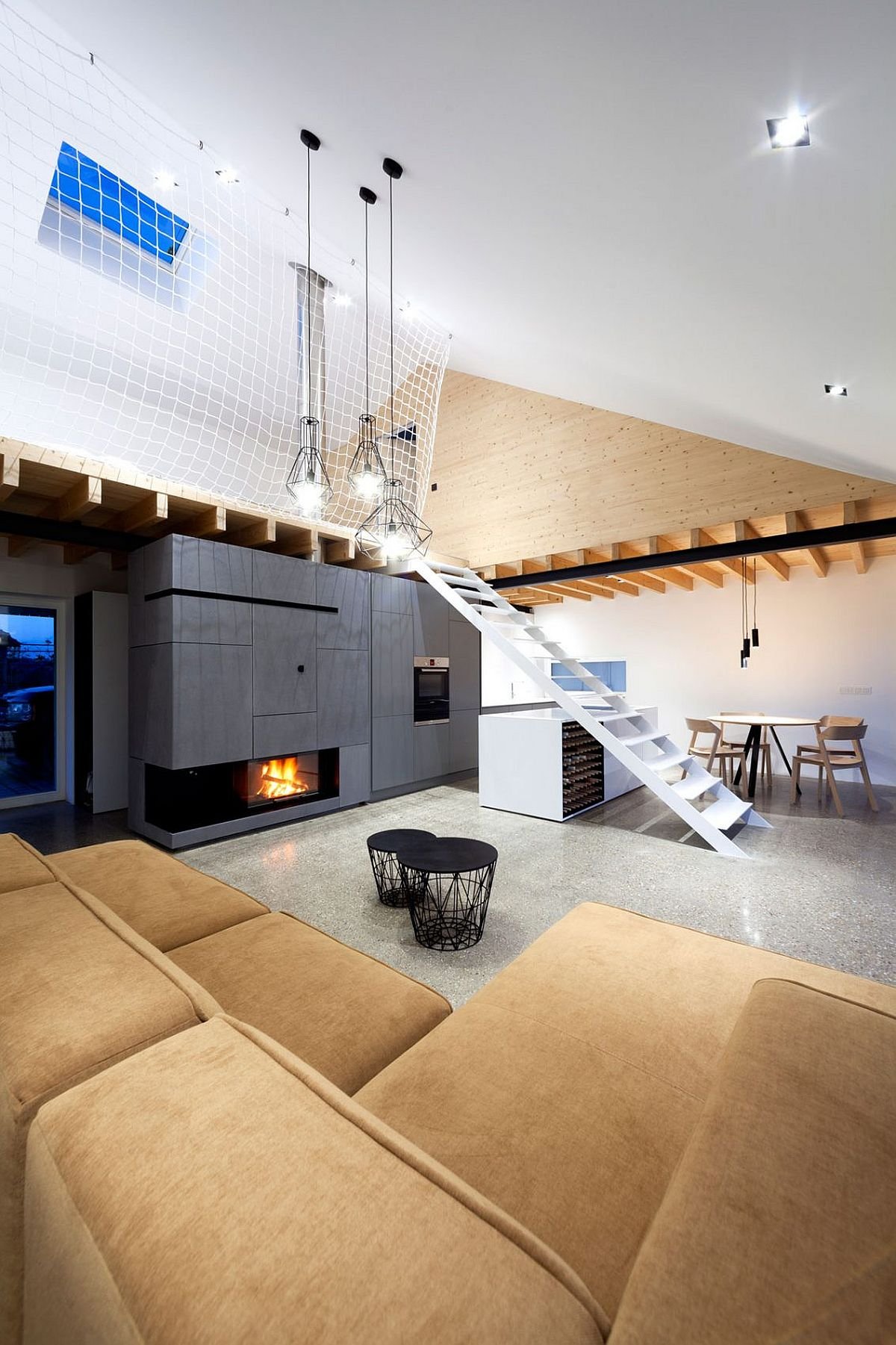 Loft style interior of the Slovakian home with mezzanine level