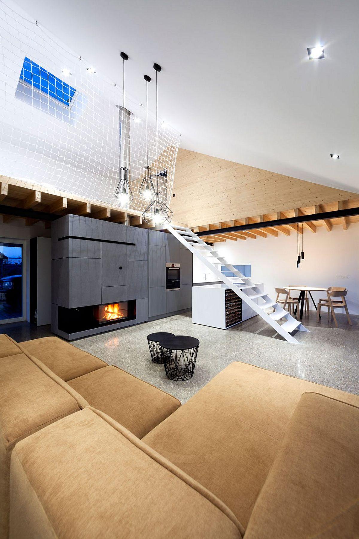 Loft style interior of the Slovakian home with mezzanine level