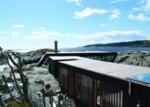 Long structure of the summer home connect different rocky islets