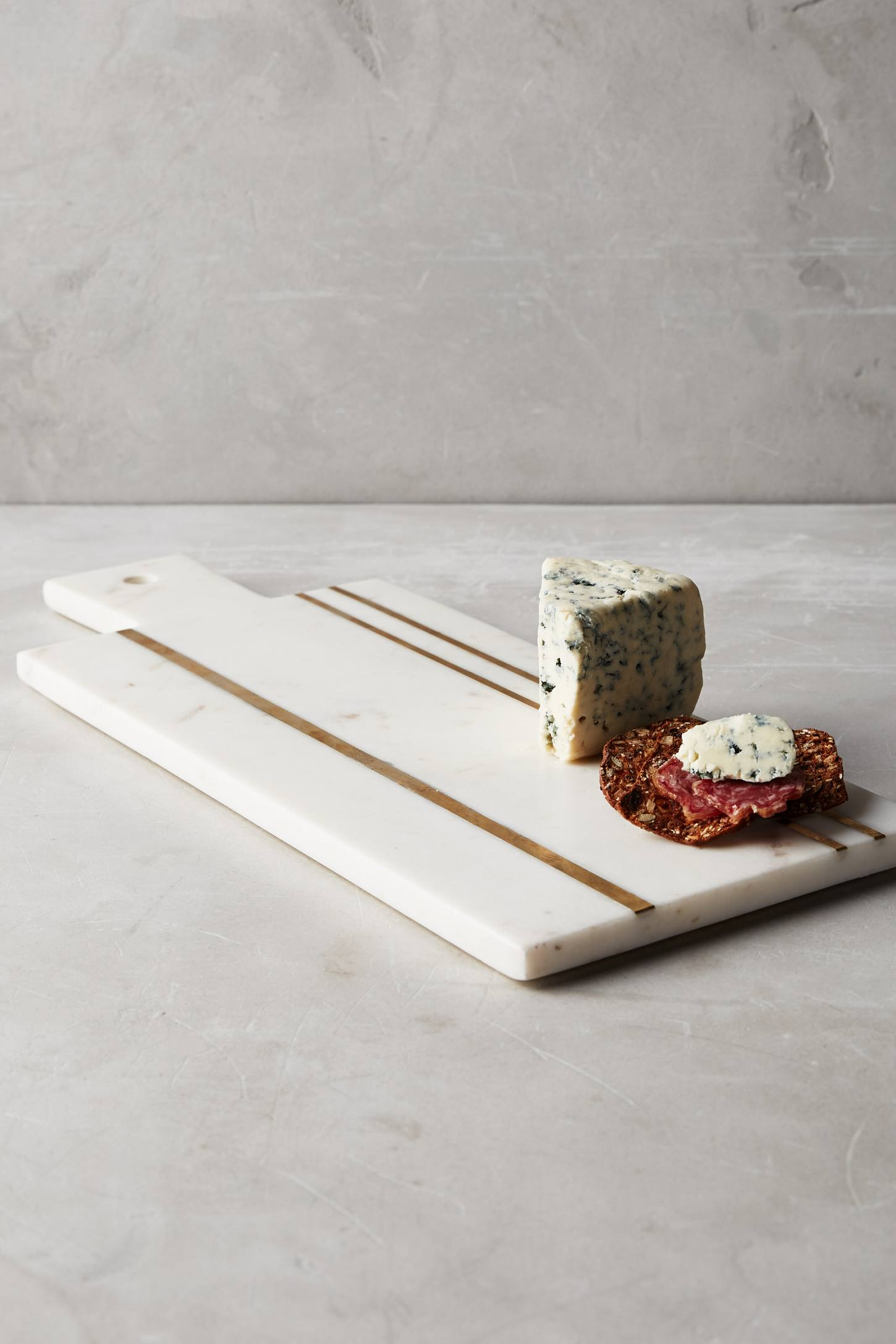 Marble and brass cheese board from Anthropologie