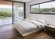 Master bedroom and deck outside with unabated views of the scenery outside