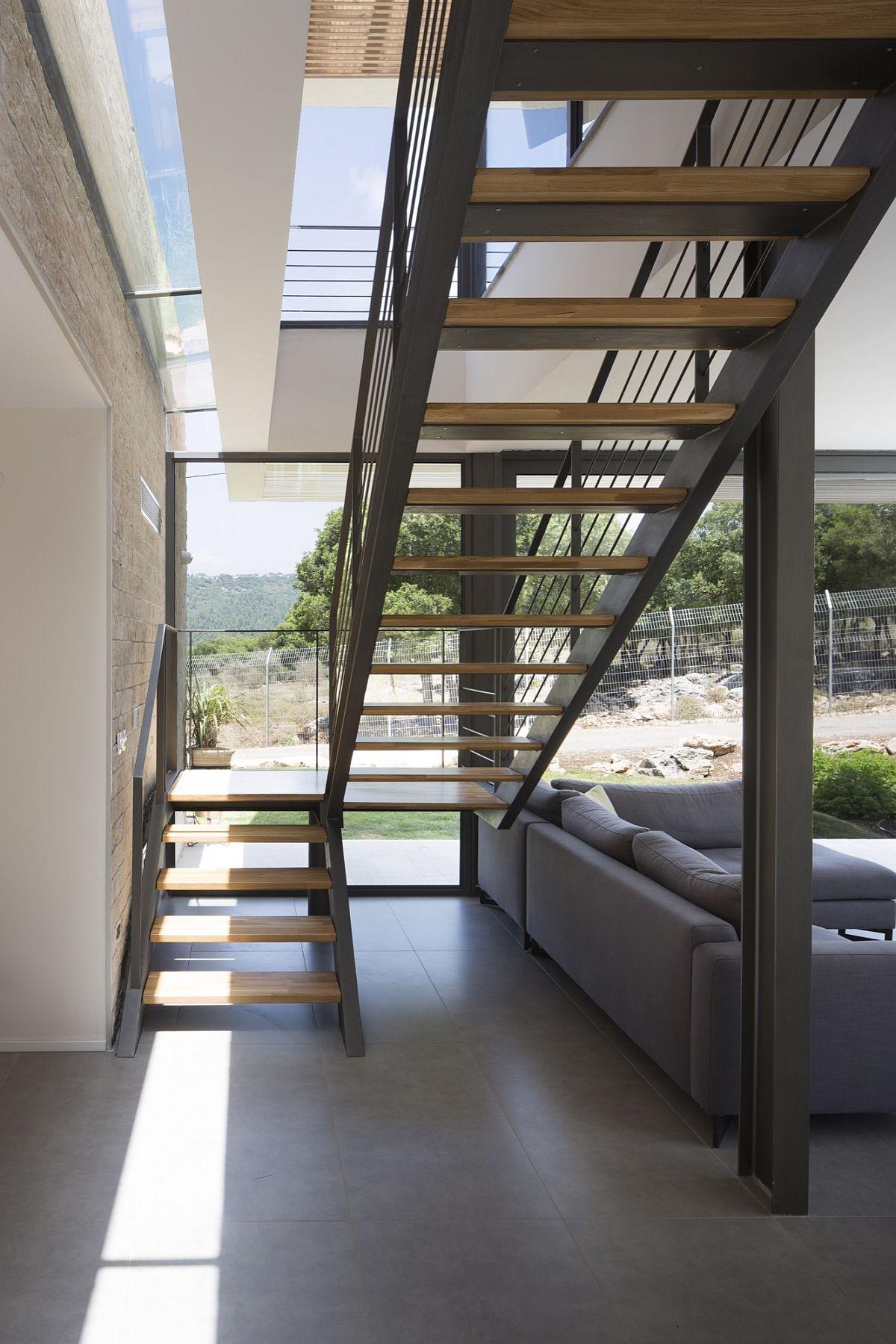 Metallic staircase gives the interior an edgy contemporary vibe