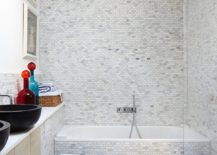 Modern bathroom in white with tub and shower area
