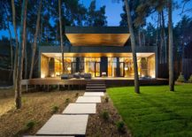 Modern chalet in Ukraine designed to intergrate visually with the forest around it
