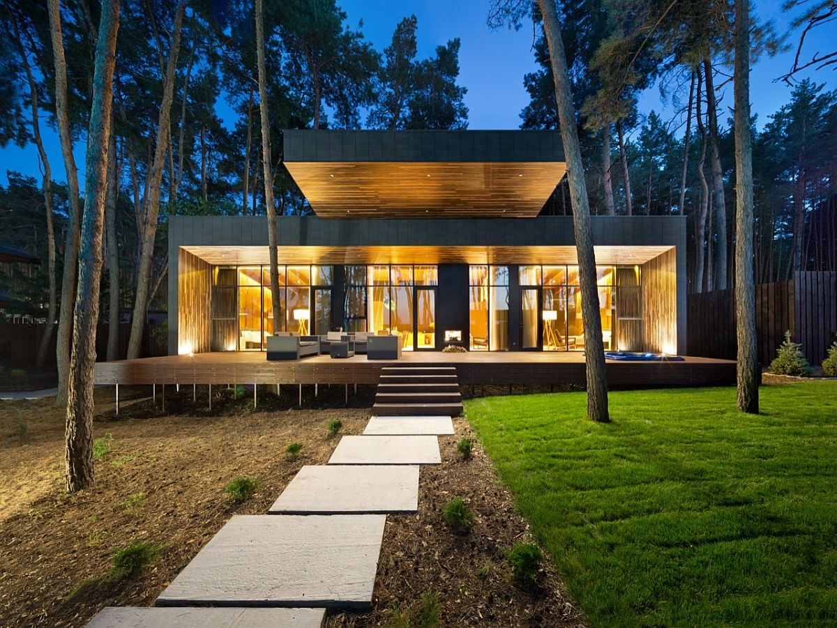 Modern chalet in Ukraine designed to intergrate visually with the forest around it Inspired by the Forest: Modern Chalet in Poltava Unveils Refined Serenity