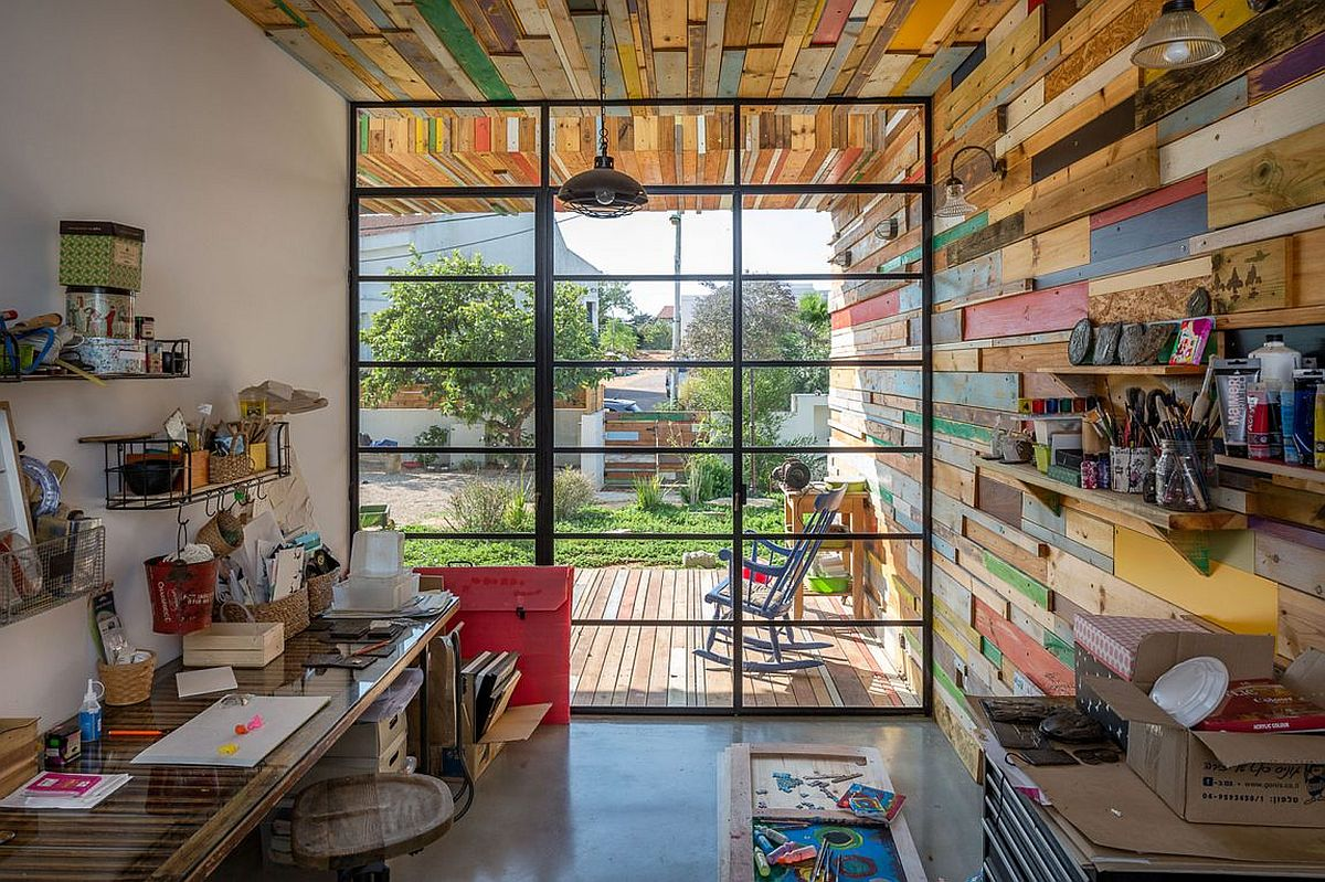 View In Gallery Modern Industrial Studio With Large Window And Reclaimed Wood Walls