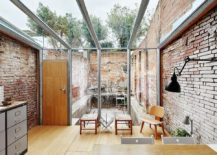 Modern industrial sunroom with lovely brick walls and a glass ceiling