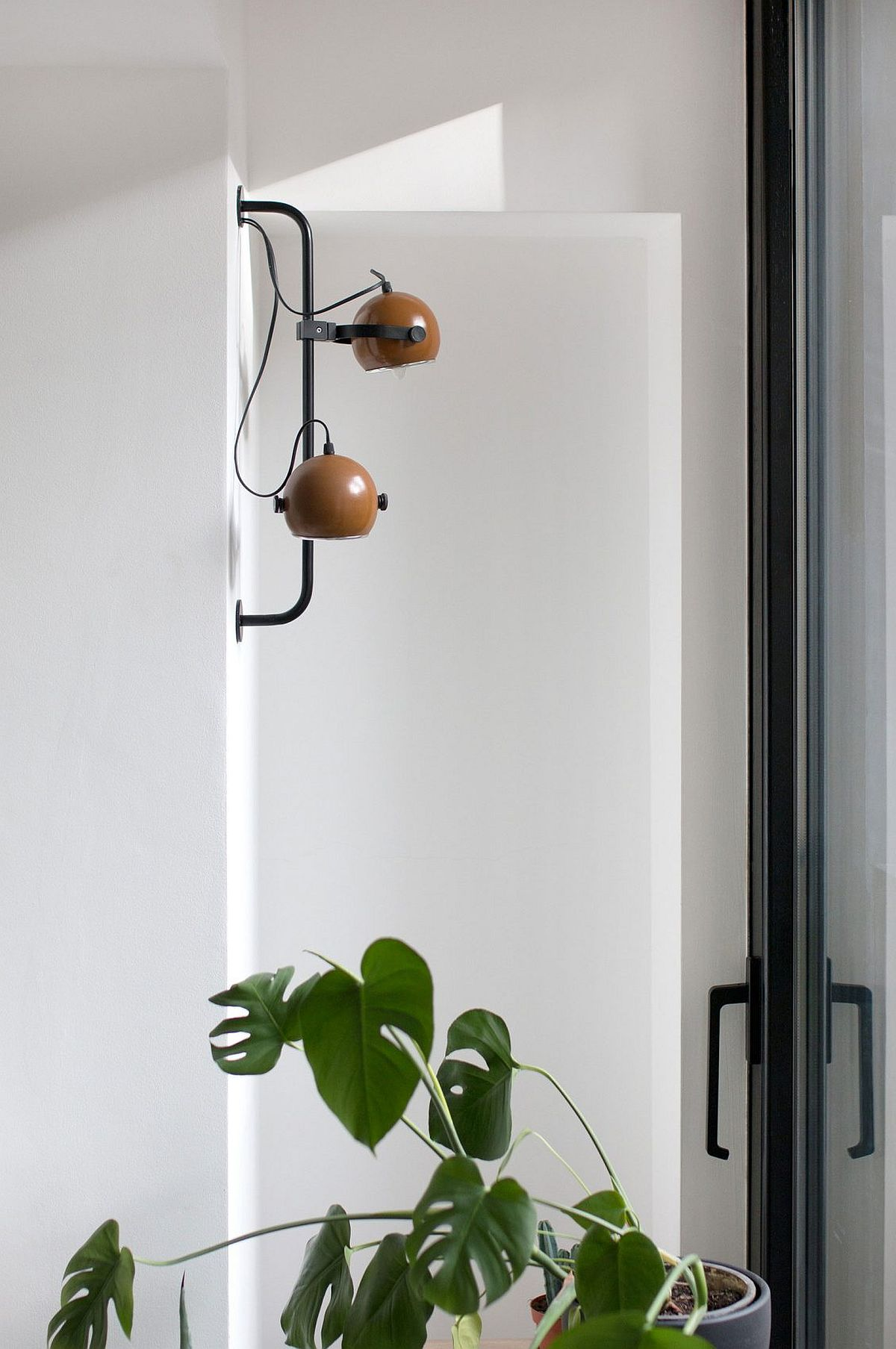 Modern lighting coupled with custom decor inisde the cool apartment in Belgrade
