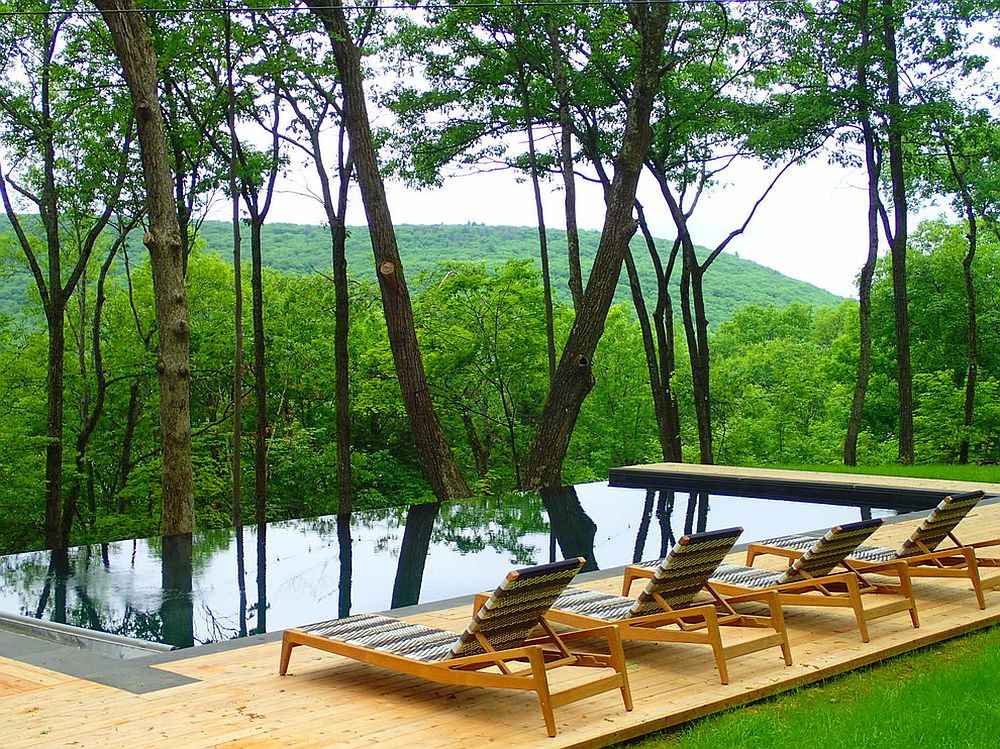 Modern pool and deck overlook mountains and the lush green forest [Design: NeJame Pool Specialists]