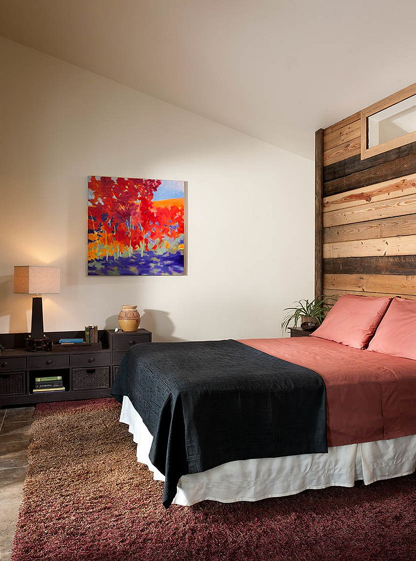 Modern rustic bedroom with reclaimed wood accent wall [Design: Mindful Designs]