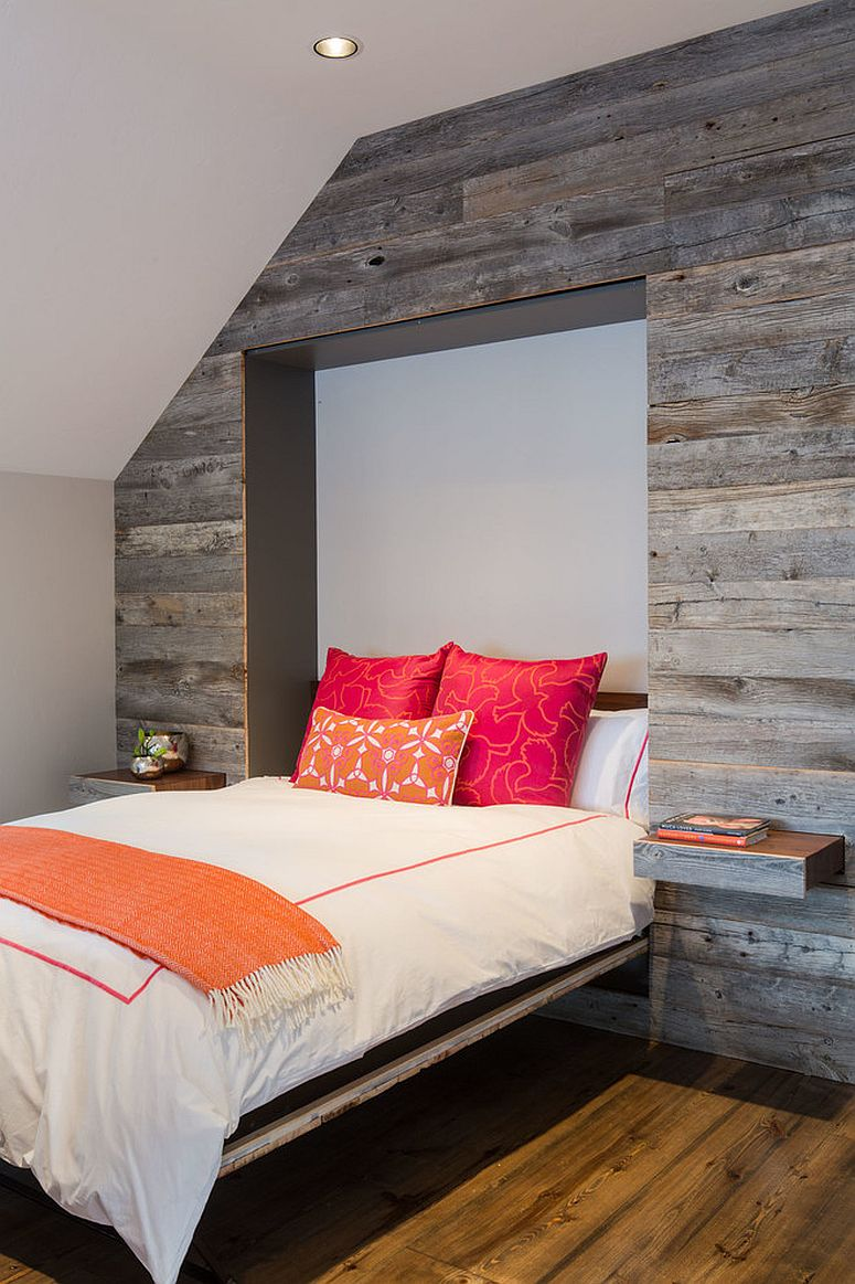Murphy bed and pull-out nightstands disappear into the reclaimed wood wall when not needed [From: David Agnello Photography]