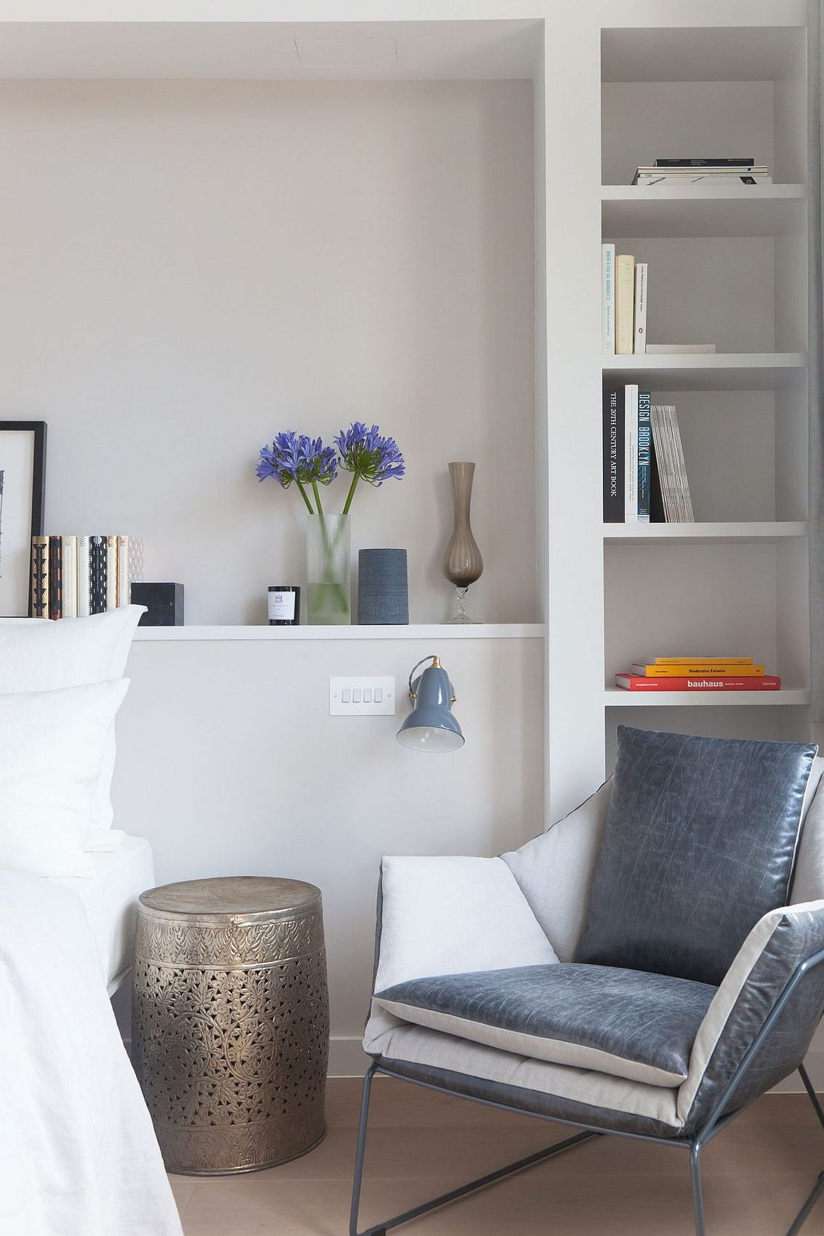 Nightstand adds a silvery touch to the bedroom in white