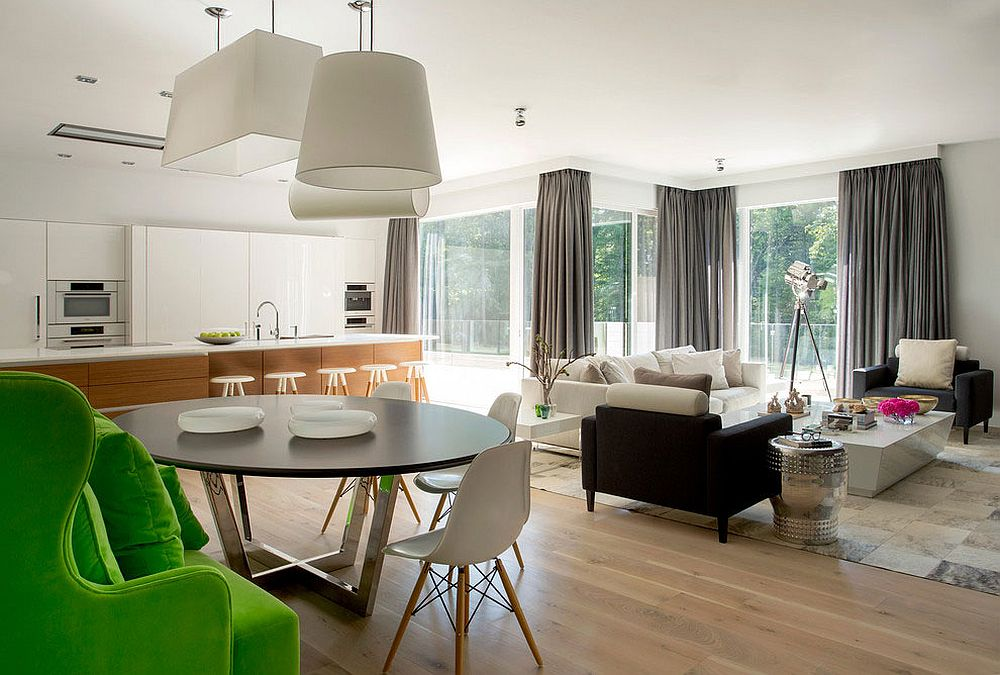 Open plan living area with kitchen in white and a wooden island