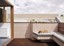 Outdoor terrace and lounge with custom bench that ofers plush seating