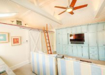Pastel blues and corals are perfect for the beach style home theater