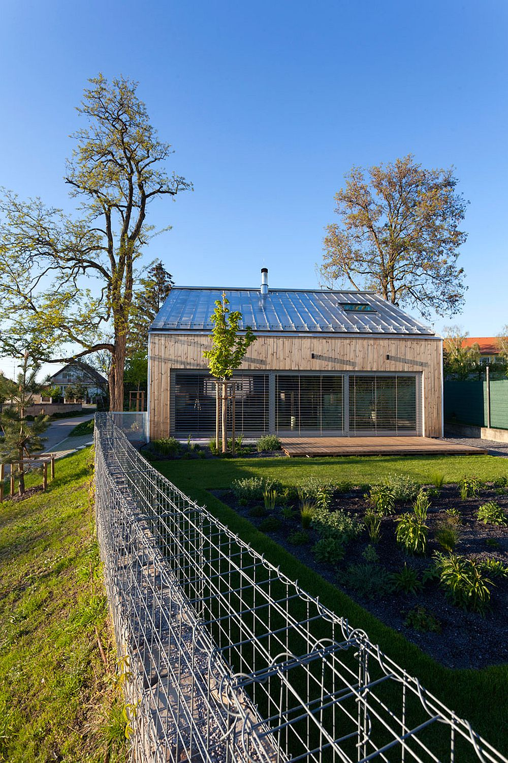 Private garden of the modern home with a wooden deck