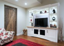 Reclaimed barn door for the beach style home theater