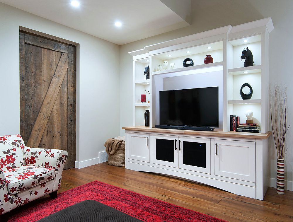 Reclaimed barn door for the beach style home theater [Design: Bow Valley Kitchens / Bob Young Photography]