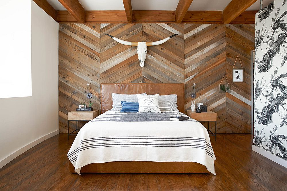 Reclaimed wood wall with chevron pattern steals the show in this bedroom [Design: Studio Revolution]