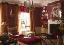 Red drawing room with a chandelier