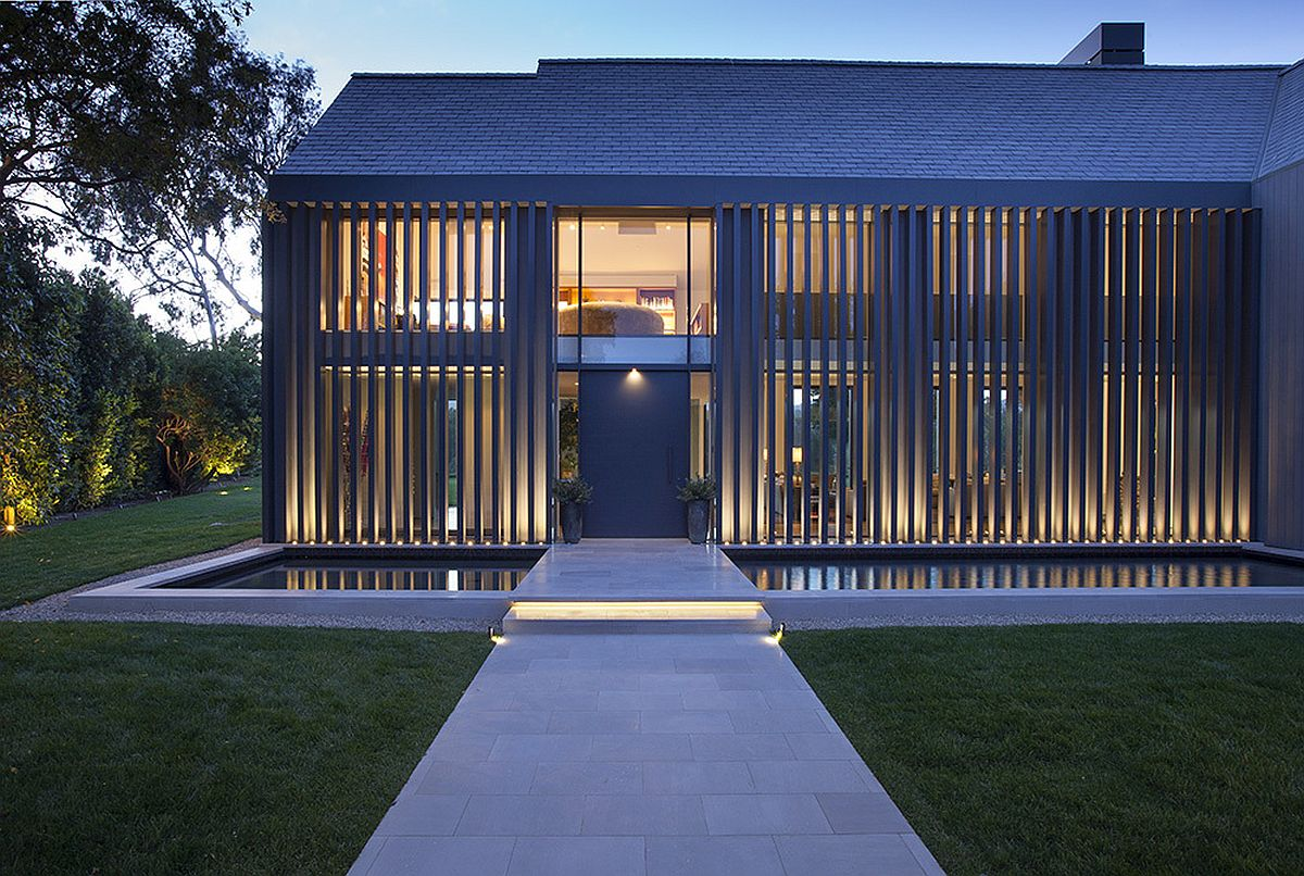 Reflecting pond and bridge create a stunning entrance at the revamped LA home