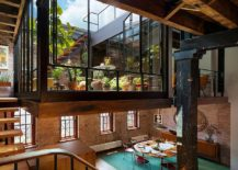 Revamped mezzanine level inside Tribeca Loft functions as a stunning industrial sunroom
