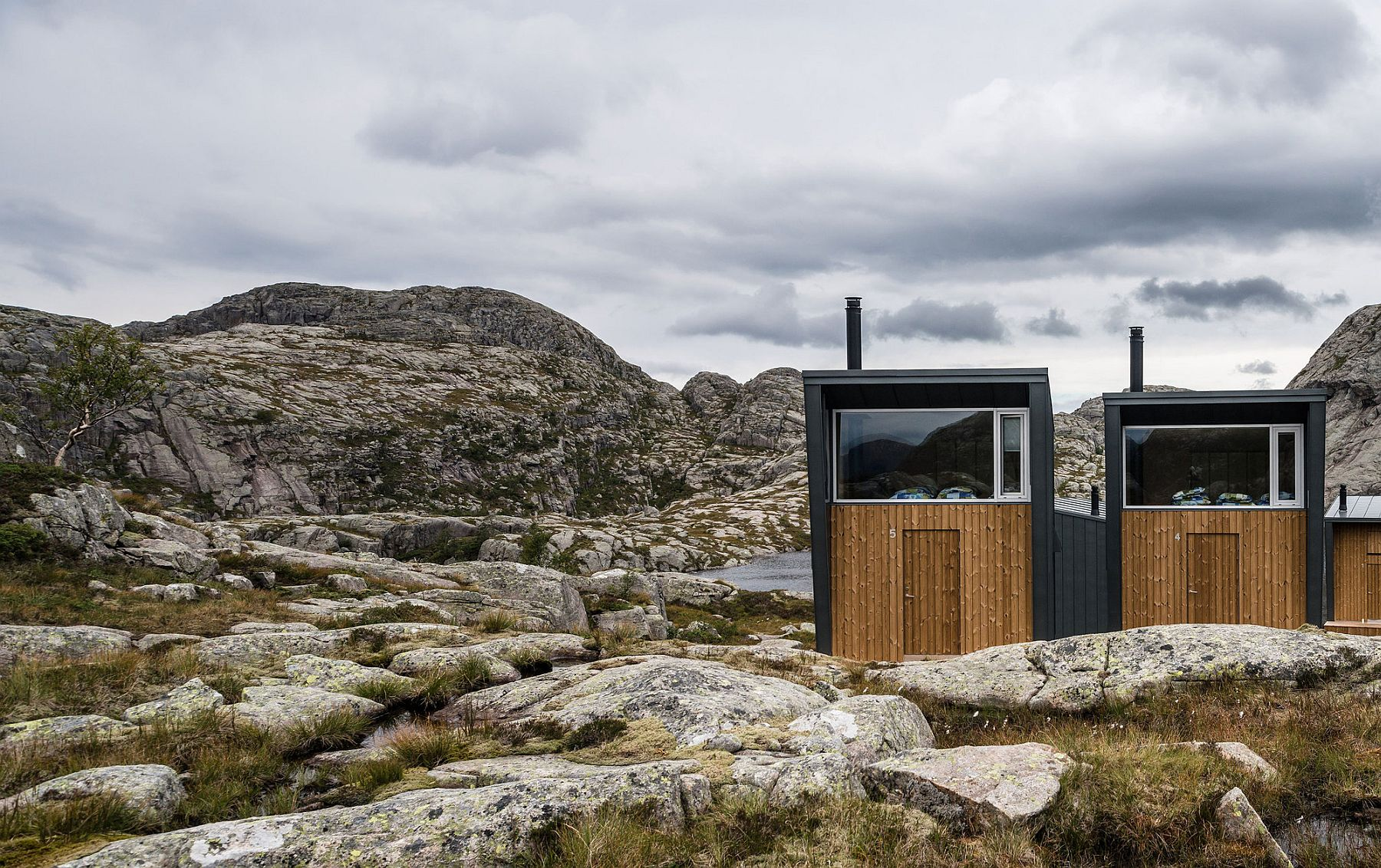 Rolled zinc and wood shape the exterior of the cabins