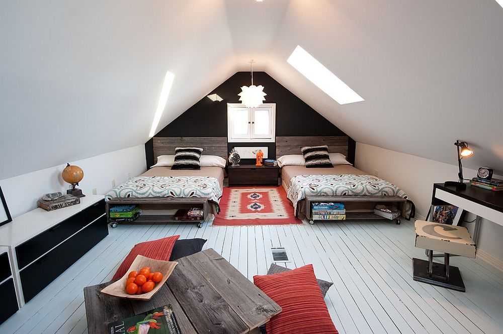 Rustic kids' attic bedroom with skylight and a neutral color scheme