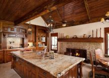 Rustic kitchen with classic stone fireplace