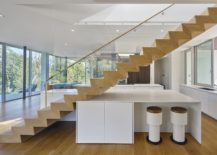 Sculptural-staircase-with-smart-island-and-breakfast-zone-underneath-217x155