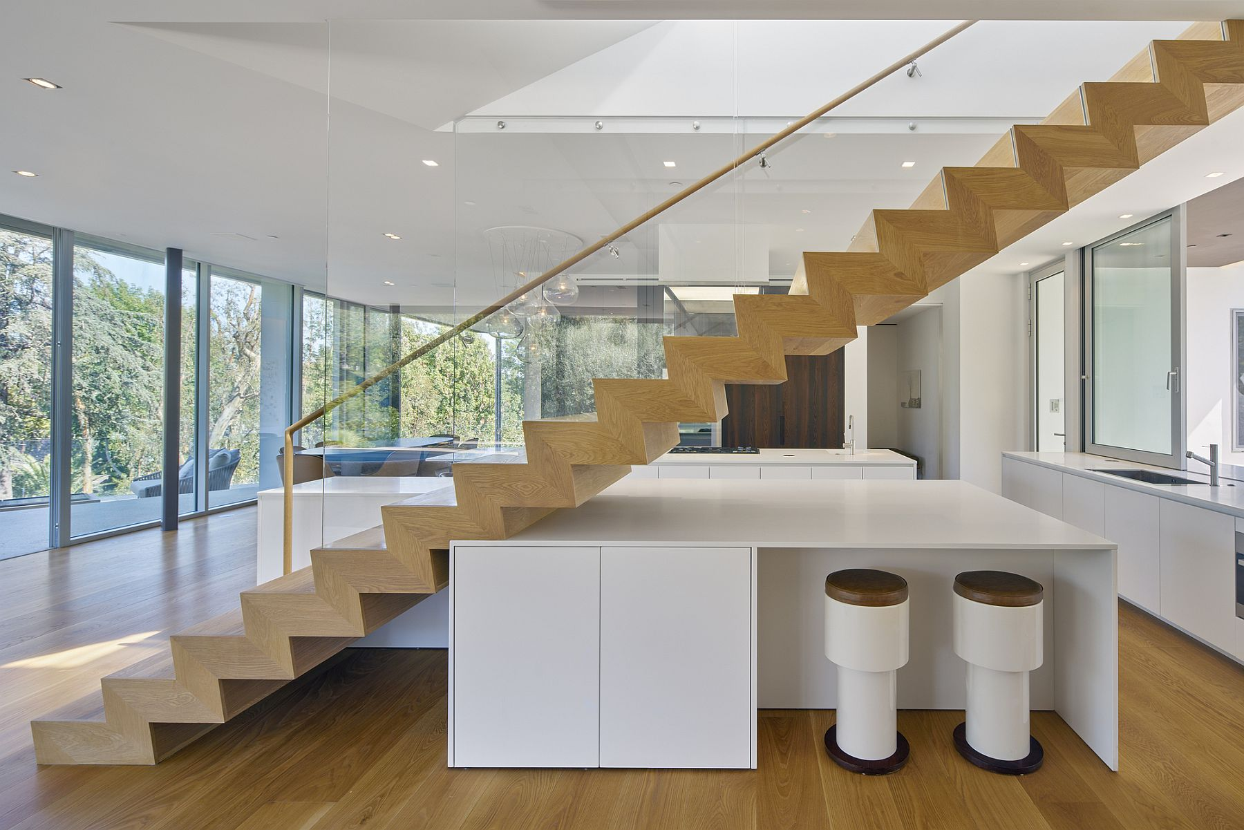 Sculptural staircase with smart island and breakfast zone underneath