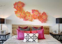Sculptural-wall-art-above-the-live-edge-headboard-in-the-contemporary-bedroom-217x155