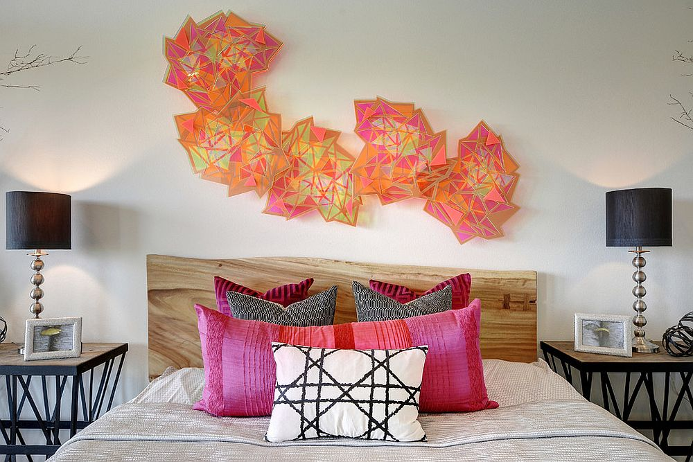 Sculptural wall art above the live-edge headboard in the contemporary bedroom [Design: Chelsea+Remy Design]