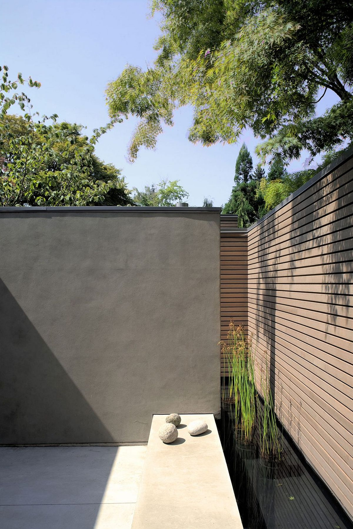 Series of minimal landcsape features and ponds surround the tranquil retreat