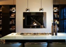 Sleek and stunning fireplace becomes the focal point of this awesome contemporary kitchen 217x155 Hot Trends: Give Your Kitchen a Sizzling Makeover with a Fireplace!