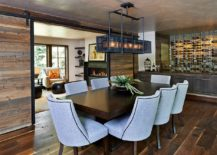 Sliding barn doors bring reclaimed wood to this rustic dining room