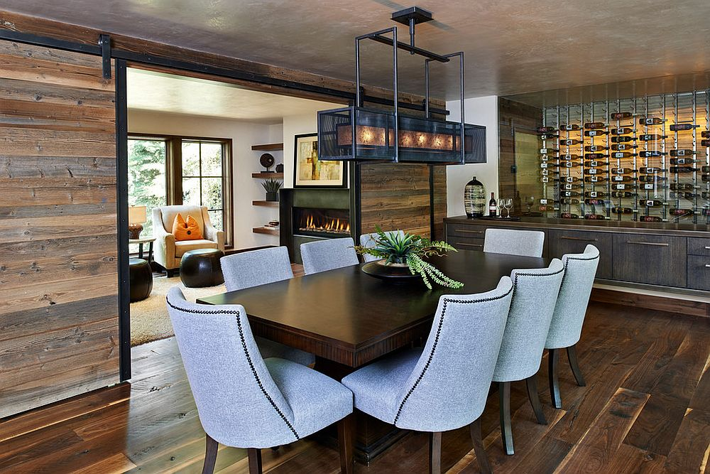 Sliding barn doors bring reclaimed wood to this rustic dining room [Design: Gregg & Co Builders]