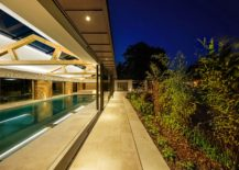Sliding-glass-doors-connect-the-pool-house-with-the-landscape-and-the-house