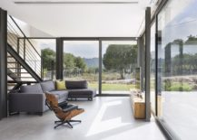 Sliding glazed doors connect the interior with the view outside
