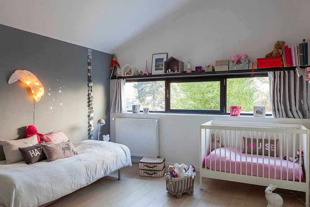 Small industrial nursery design idea in white with gray feature wall