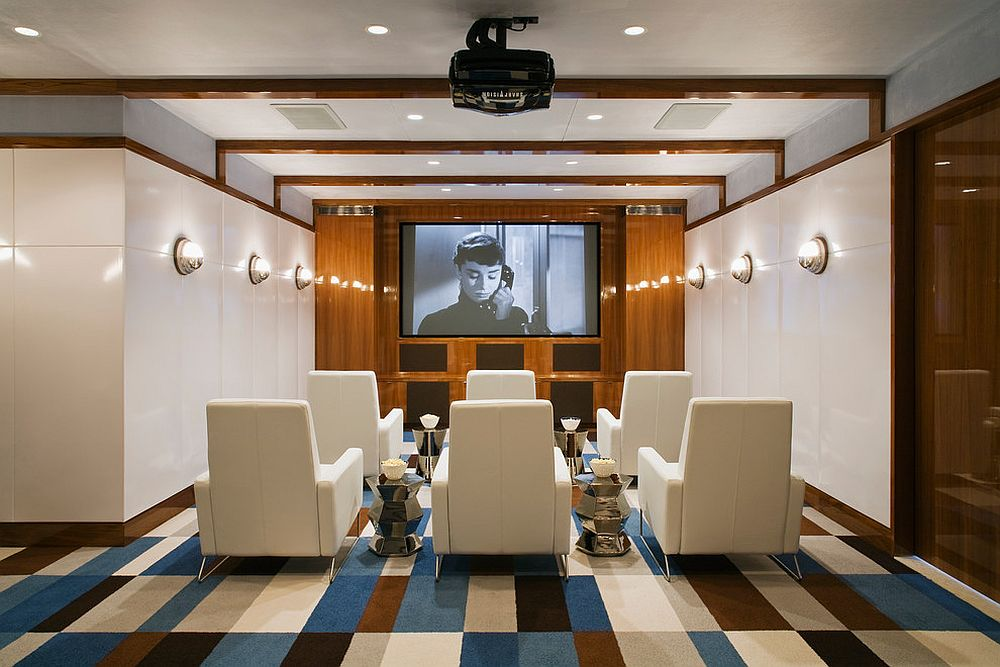 Smart beach style home theater in white with colorful flooring [Design: Alexander Gorlin Architects]