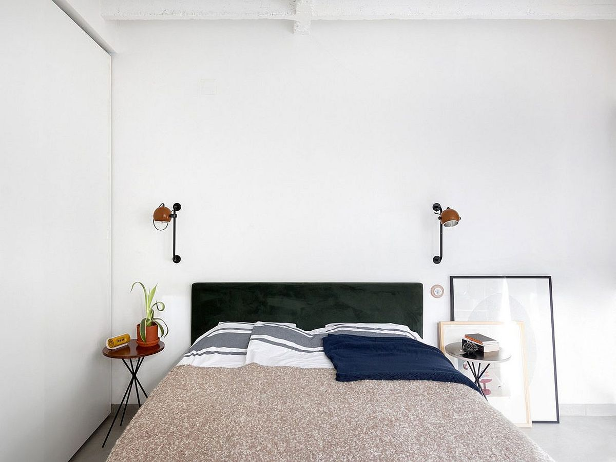 Smart bedroom design with small bedside stand and artwork