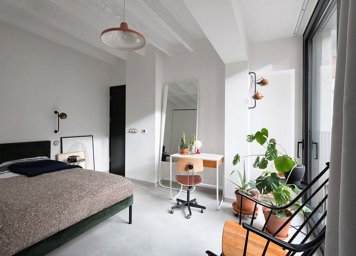 Smart bedroom in neutral hues with modest workspace