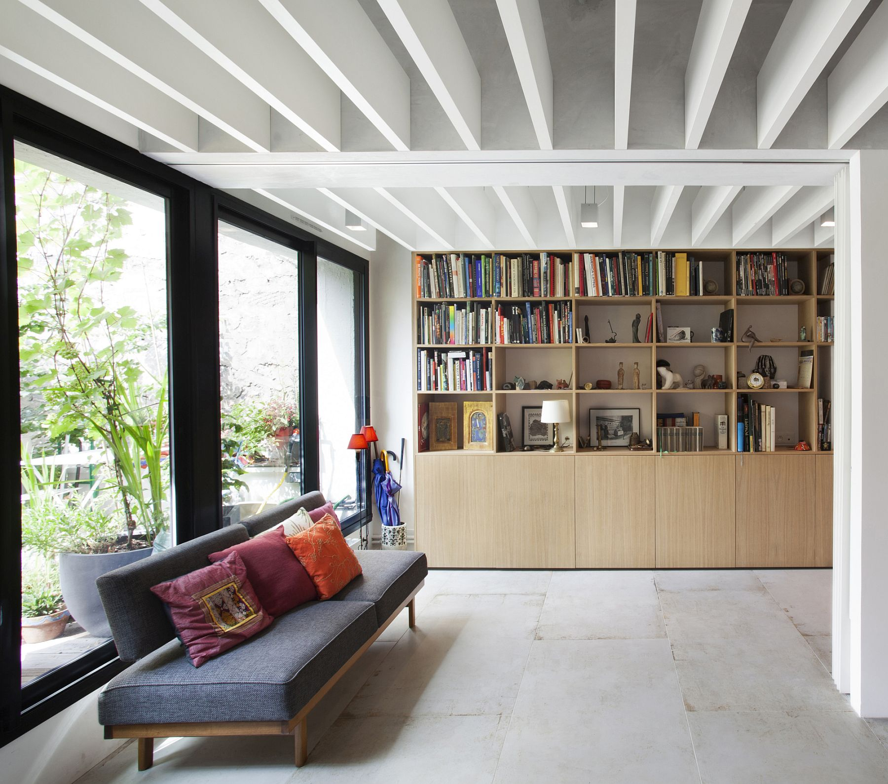 Smart decor and bookshelf add color and class to the revamped Paris apartment