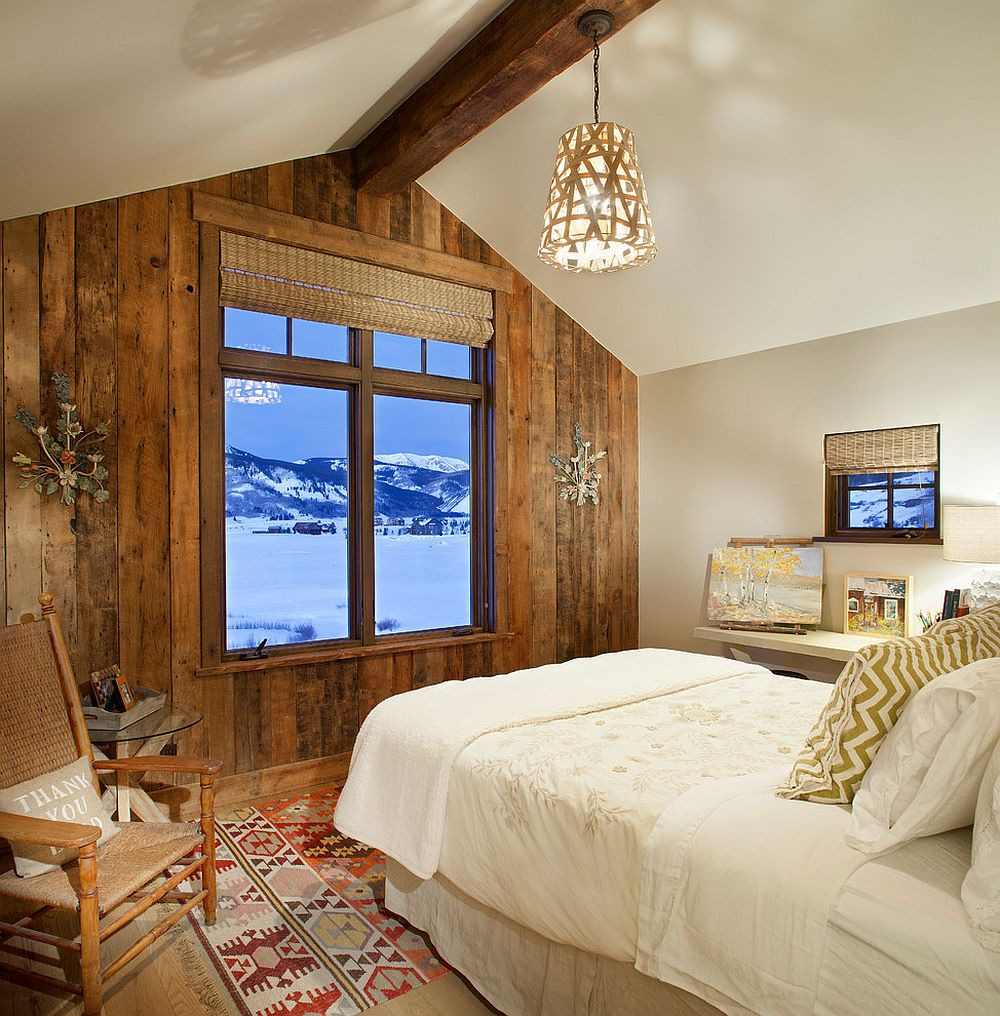 Spacious and serene rustic bedroom with reclaimed wood accent wall that frames the view outside [Design: Sunlit Architecture]