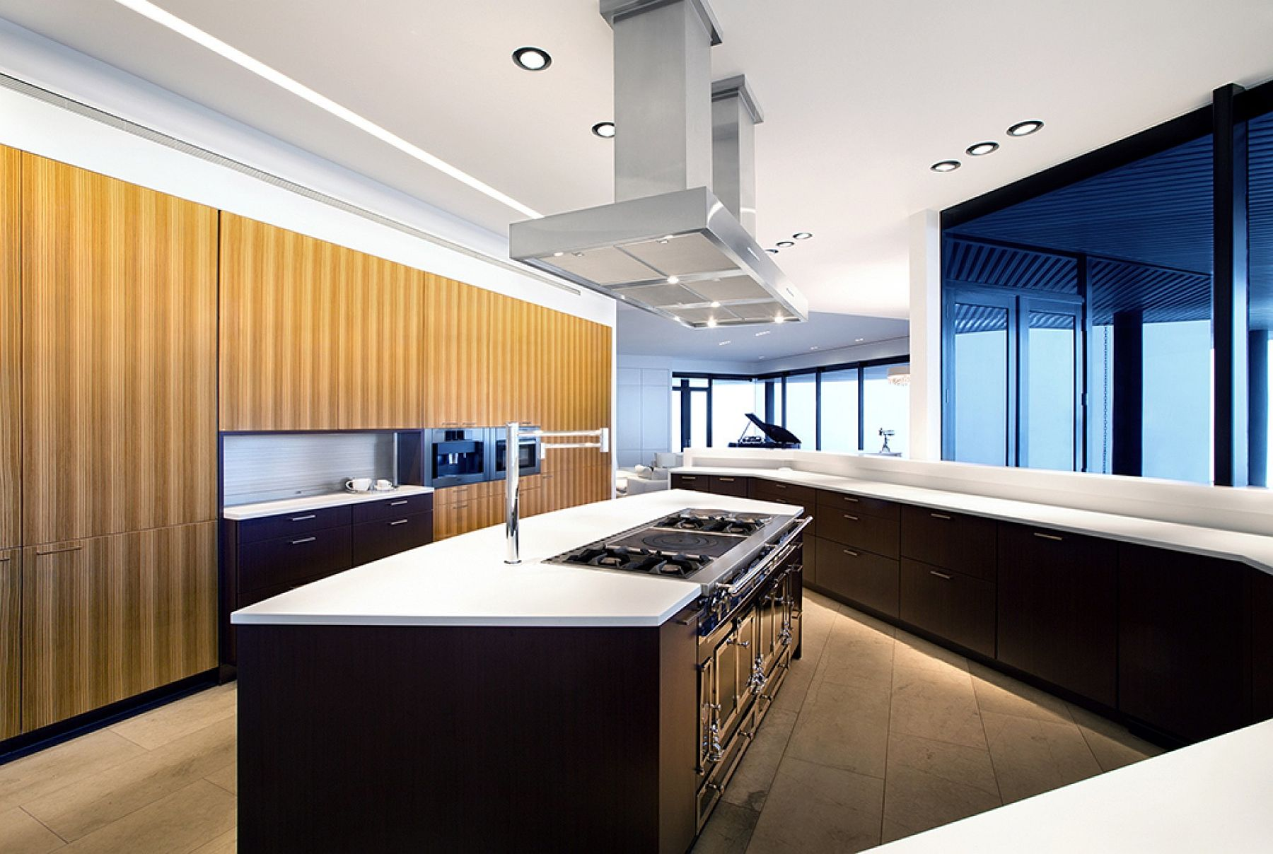 Spacious contemporary kitchen with unique workstation and state-of-the-art island